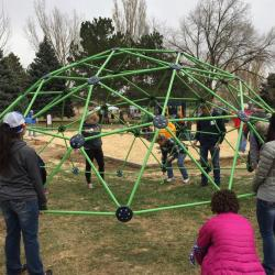 Volunteers help build a playground in Pueblo, Colorado