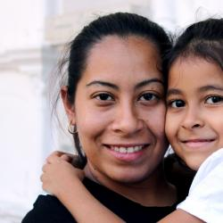 Columbian mother and daughter hugging.