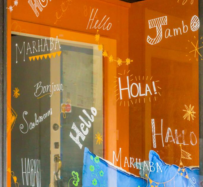 Storefront with hello written in different languages.