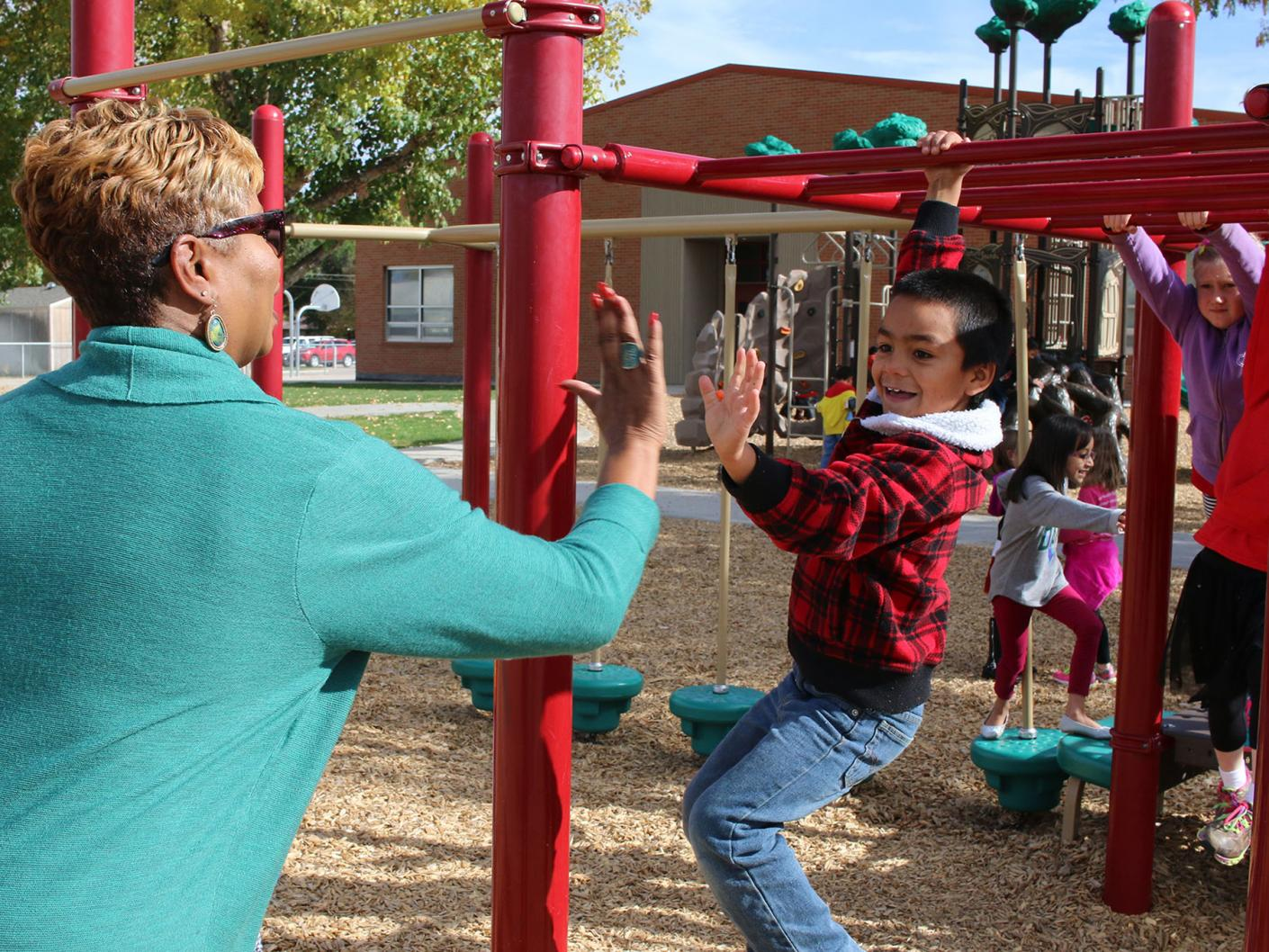 Karen high fives boy on playground