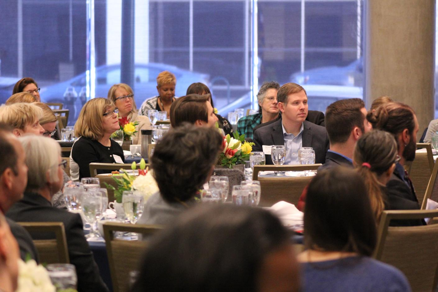 Participants sit at tables during a Colorado Health Foundation supported event.